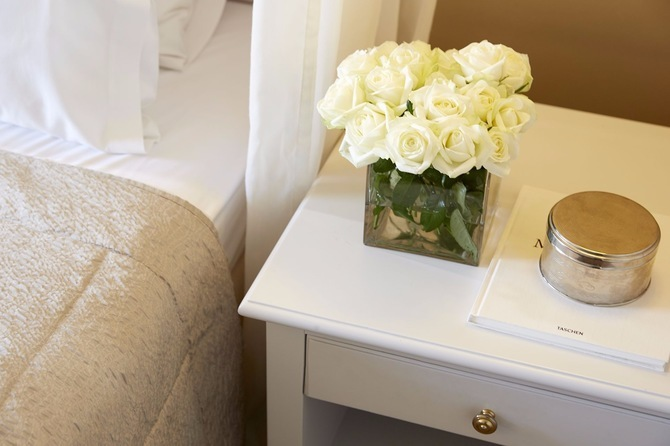 Vase with flowers by the bedside table 1